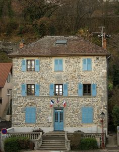 Love the color of the window shutters on this old French house in Corenc