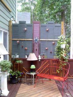 Turn garage-sale shutters to block a close neighbor's view, or your view of their deck! | Photo: The Garden Frog Boutique with C. Renee, courtesy of @hometalk