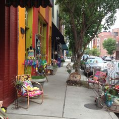 Looking north down the sidewalk past LOFT (Lost Objects Found Treasures), on Broadway in downtown ...