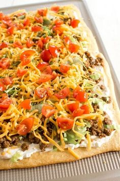 Taco Pizza Appetizer with a crescent roll crust. Easy cream cheese sauce is so zesty! #appetizers #easyappetizer #superbowl #superbowlparty #tacotuesday