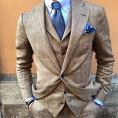 Tan, window pane, blue tie and pocket square