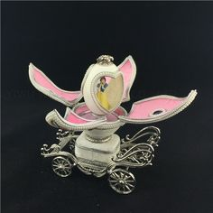 This exquisite and romantic Goose Egg Carriage Musical Box is delicately hand carved and adorned with faux pearls. It is genuine goose egg shell treated with reinforcement method. Jewelry Box, Jewelry Necklaces, Wedding Carriage, Necklace Box, Hand Carved, Carving, Romantic, Pearls, Music
