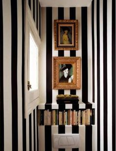 Black and white striped bathroom. Did this in my biggest bathroom but painted brown stripes between the black ones....too much....had to paint them out. Lot of work but I love the look.