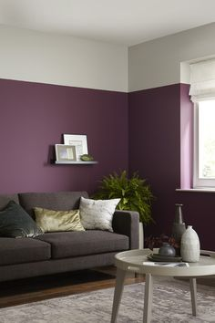 Addiction purple, sharply contrasted against Grey Putty to create a beautiful two-tone wall in the Faded Berries trend.
