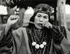 Here is an Ainu woman playing the same kind of jaw harp that Ulchi shaman, Grandfather Misha Duvan played.