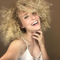 Curl power! Aveda blonde hair color by Aveda Artists Lupe Voss and Luis Gonzalez. Incredible curl styling by Aveda Artist Diana with Aveda makeup by Jonathan Krugman.