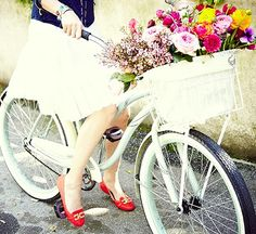 Now that my legs are fixed, I want to go biking with a knee length white skirt, red flats and a basket full of flowers!