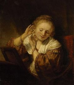 Rembrandt's Young Woman Trying on Earrings.