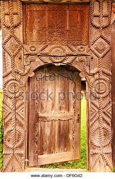 19th century traditional Iza Valley farm house carved wooden folk art gates, The Village museum near Sighlet, Maramures, Norther - Stock Photo