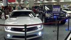 """Upon entering the First Hawn Bank Auto Show you're greeted by the flashing lights of the police cars from """"Hawaii 5-0"""". Danno's Camaro and McGarrett's Chevy truck."""