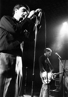 Joy Division: Ian Curtis and Peter Hook onstage at The Factory, photo by Kevin Cummins, Manchester, 1979
