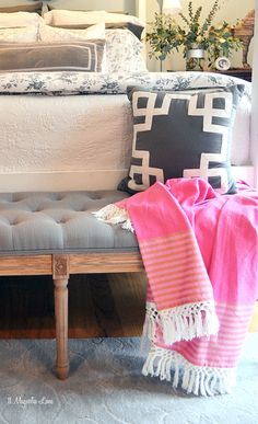 Soothing greys and whites (with a pop of pink for fun) make the master bedroom feel peaceful and spa-like.  Stock up on throw pillows and bedding at HomeGoods, and don't forget to add a gray tufted bench at the foot of the bed!  {Sponsored pin}
