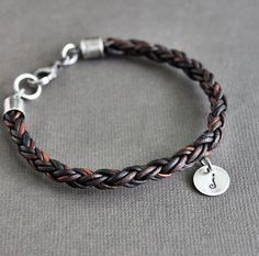 Leather Charm Bracelet Braided Cord Sterling Silver. $52.00, via Etsy.