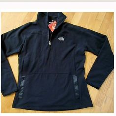 The North Face 1/4 Zip Fleece So cute and perfect for this time of year! Perfect for layering during cool-weather excursions, this fleece pullover is as warm as it is soft. This lightweight and breathable jacket has a quarter zip, allowing you to ventilate during highly aerobic activities. Quick-drying fleece won't remain soaked and cause your temperature to drop if you get wet outdoors. North Face Jackets & Coats