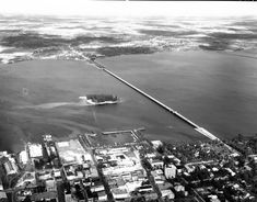 Aerial view of Thomas A. Edison memorial bridge over the Caloosahatchee River next to Lofton Island at Fort Myers - Lee County, Florida 1947