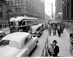 PCC streetcar 4107 on Queen Street East, Toronto, December 4, 1954. #vintage #Canada #streets #1950s