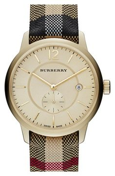 Free shipping and returns on Burberry Textured Dial Watch, 40mm at Nordstrom.com. A scratch-resistant sapphire crystal face protects the textured dial of a demure round watch detailed with a chic subseconds dial, date window and smooth strap.