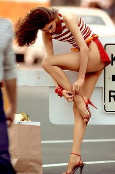 Leggy model in high heels with girlie problems