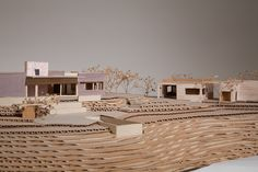 Model from Bestor Architecture-made from cardboard, chipboard and foam core...love the natural, neutral look of it!