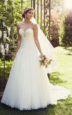 Tulle over Satin A-Line wedding dress featuring Diamante-beaded Lace throughout a fitted sweetheart bodice with a tulle skirt and traditional train.