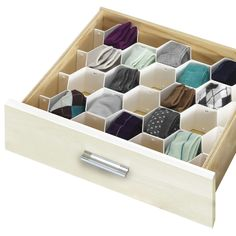 This 34-Compartment Honeycomb Drawer Organizer is ideal for storing all of life's little treasures. The unit snaps together easily and can be used to store jewelry, cosmetics, or even delicates.