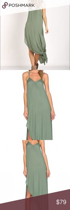 """NWT Free People Women's Small Slip Dress Small women's dress - can knot or not - pun intended :). Light weight and soft and great for the summer, Coachella, or summer nights.   Shoulder seam to hem measures approx 55"""" in length.  Selling for girlfriend - no trades please.                                                                   - 100% rayon - Side Slits - Small Free People Dresses Backless"""