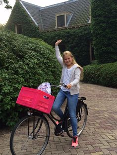 24.08.2015.  Princess Amalia on the bike, on the way to her first day at high school. King Willem-Alexander made this morning itself this snapshot.