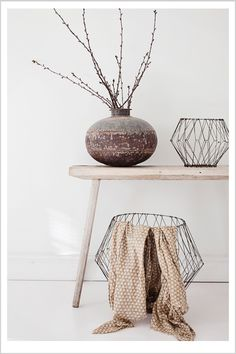 baskets, pot wood white minimal home decor this website has the coolest stuff... Can't read it tho