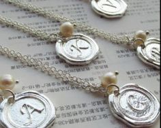 Free In't Shipping! A necklace with a letter sealed with silver and an unique pearl