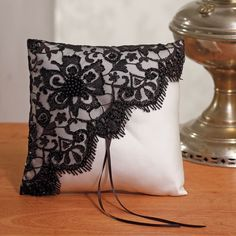 Baroque ring bearer pillow This Black Lace ring pillow is ideal for a baroque themed wedding. It measures 20 x 20 cm. The pillow is white satin covered with a black piece of lace. Black beads adorn the lace for a chic touch. Ring Bearer Pillows, Ring Pillows, Throw Pillows, Cushion Cover Designs, Deco Retro, Lace Ring, Ring Pillow Wedding, Wedding Ring, Cushion Ring
