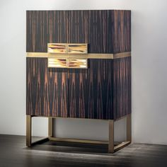 For Sale on - Handcrafted to the highest degree of excellence, our Cosmopolitan bar cabinet is formed with Macassar ebony veneer in a matte finish, standing upon a burnished Luxury Furniture, Cool Furniture, Furniture Design, Luxury Interior Design, Interior Design Inspiration, Modern Cabinets, Bar Cabinets, Cabinet Design, Cabinet Ideas