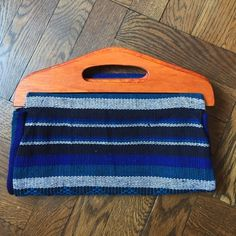 """Fold over clutch! Handmade and crafted in Mexico with all local textile and wood! Use it folded or long! Beautiful and unique. No two alike. 11"""" w and 6.5"""" folded or 14"""" L. 5.5"""" deep! Costume Baldor Bags Clutches & Wristlets"""
