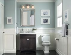 Hide toiletries tastefully in a dark vanity. A cool, pale blue wall color keeps the room current and fresh.
