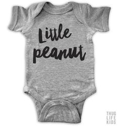 Little peanut!  White Onesies are 100% cotton. Heather Grey Onesies are 90% cotton, 10% polyester. All shirts are printed in the USA.