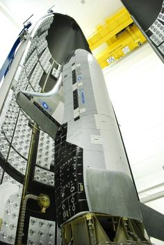 FILE - This Feb. 8, 2011 file image provided by the U.S. Air Force shows the X-37B during encapsulation within the United Launch Alliance Atlas V 5-meter fairing in Titusville, Fla. The unmanned Air F