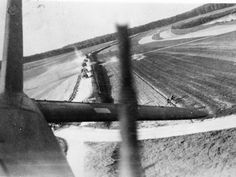The gunner in a Fairey Battle captures a photograph of Wermacht soldiers running for their lives (just above horizontal stabilizer) after their convoy was strafed by his pilot. After the Phoney War, a period of some eight months after September 3, 1939 when the Germans and Allies did not engage on the Western Front, the Germans finally began their Blitzkrieg war, slicing into Belgium and France. This was the Battle of France.