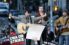 Vampire Weekend's Ezra Koenig and Chris Baio perform during the Bernie Sanders rally at Washington Square Park on April 13, 2016 in New York City   Billboard