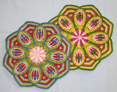 More beautiful crocheted potholders. I'd make pillows out of them.