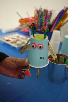 Robot - Paper cup, Clothes pin, Googly eyes (store), Pipe cleaners (store), glue