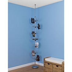 Floor to Ceiling Revolving Shoe Tree  -$64.95- Each tier holds 6 pairs of men's or women's shoes. Tiers spin independently so you can easily see and select the pair you want. Revolving Shoe Tree holds 36 pairs and works with ceilings up to 9 feet high.