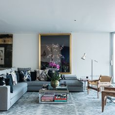 Grey and white living room with blown-up photo art | Decorating