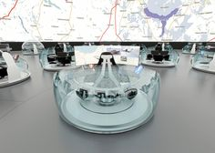 Dispatch centre proposed for Russia's Ministry of Emergency Situations, featuring a domed room filled with mobile seat pods.
