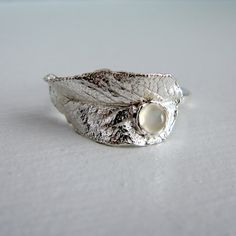 Give your bridesmaids nature inspired jewelry cast from real leaves and made from recycled silver.