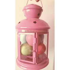 Storage for my EOS Lip Balms. Bought this lantern at ikea for like $2. Super cute (: