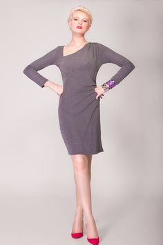 https://www.cityblis.com/8069/item/9201  April, asymmetric bodycon dress with sleeves, at 60.00% off by Arzu Kara  Asymmetric long sleeved dress with flattering gathers on the left side of the waistline. It measures 99 cm from top of the shoulder line to the hem. Perfect dress for the office! Model is a UK size 10 and 5 ft 9 wearing a size Small Made in England to the highest quality.