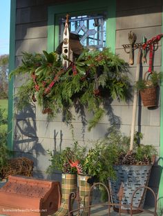 Christmas Around the Potting Shed! Greenery in window box with bird house, wellies and an olive bucket.| homeiswheretheboatis.net