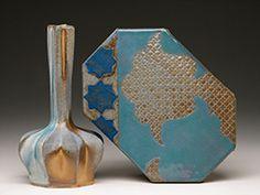 "Stephen Grimmer - OSOC Bottle and Tile: Blue Fleuron. Bottle is Cast Porcelain from 3D Modelled and Rapid Prototyped original. Tile is Handbuilt. Soda Glazed. Bottle is 11"" h x 5""w x 5""d. Tile is 11"" x 6""  x 3/4"". 2013."