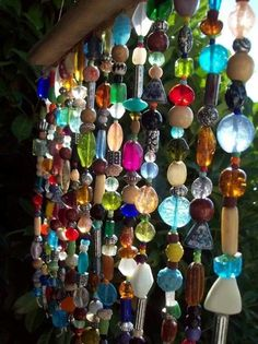 Beaded curtain to catch the sunshine, something to do with leftover beads.
