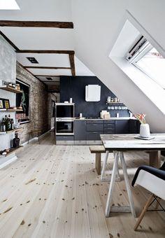 Masculine kitchen design with open kitchen storage, dark cabinets and metal handles.