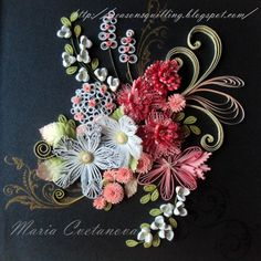 Lovely quilled floral arrangement - by:  Maria Cvetanova, as shown on the Quilling Chili FB page - https://www.facebook.com/groups/quillingchile/permalink/644711478897710/